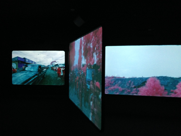 """""""The Enclave,"""" six screen video projection by Richard Mosse, 2013. Installation View."""