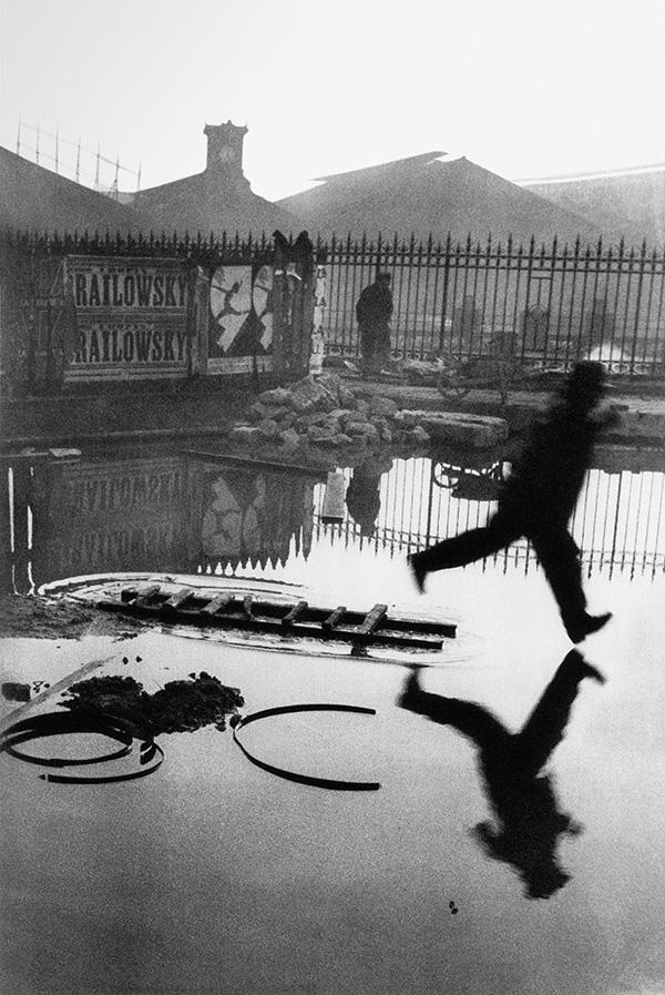 "Place de l'Europe, Paris , 1932 (also known as ""Behind The Gare St Lazare""). ©  The Decisive Moment  by Henri Cartier-Bresson, published by Steidl  www.steidl.de"