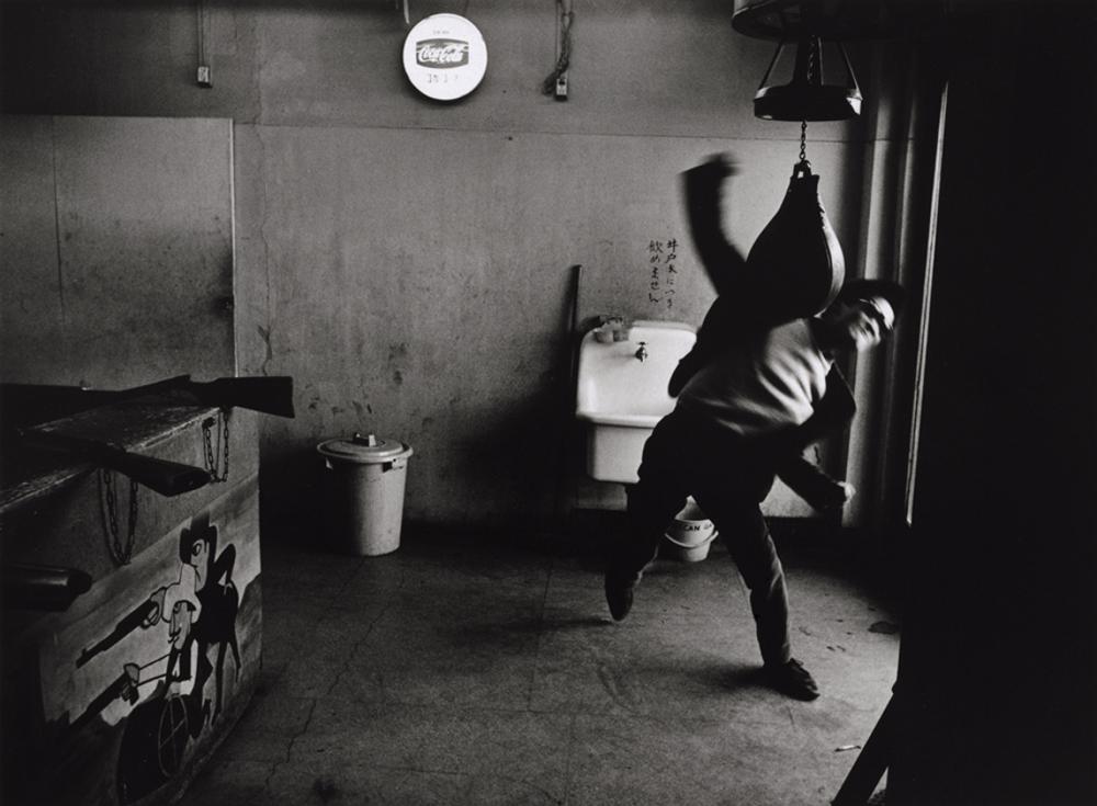 Shōmei Tōmatsu. Portrait of Takuma Nakahira, Shinjuku, 1964.