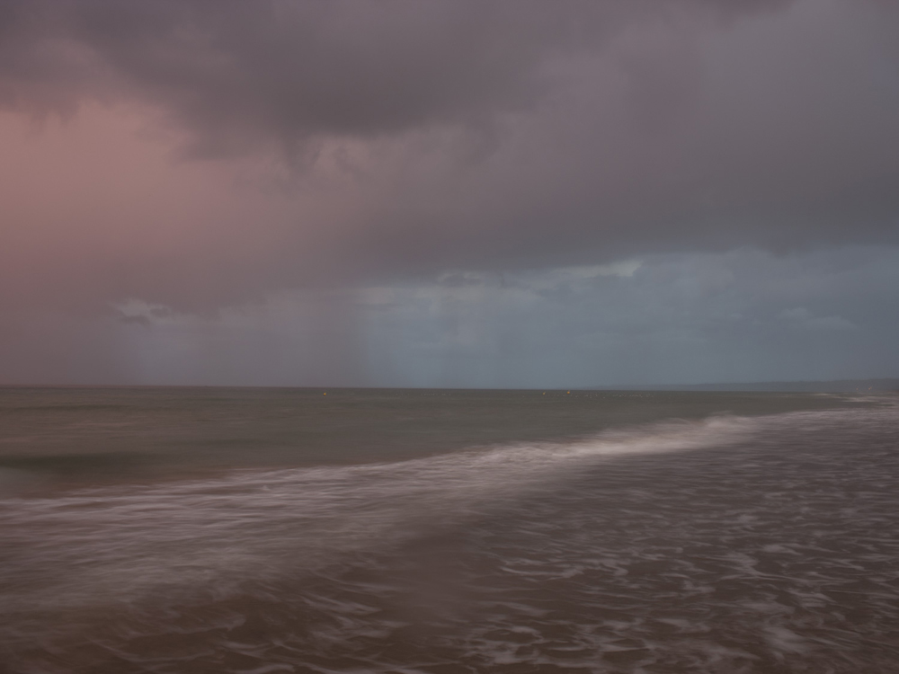 Omaha Beach, October 4, 2013, 6:39pm. 17 Celsius, 88% RELH, Wind WSW, 11 Knots. VIS: Poor, Overcast Clouds, Thunderstorms.