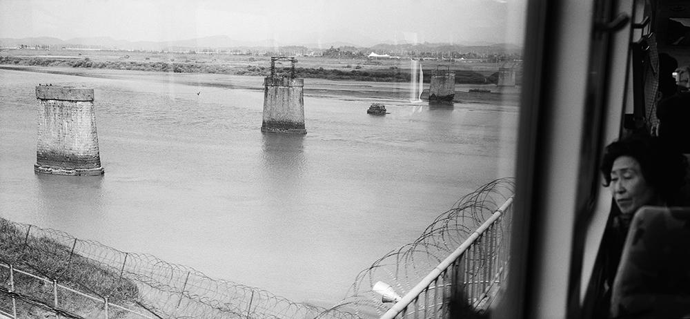 Woman looking at Freedom Bridge