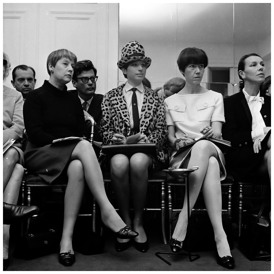Barbra Streisand in a leopard-skin suit she designed herself, with Richard Avedon sat behind her, at the Spring '66 Chanel Haute Couture show.