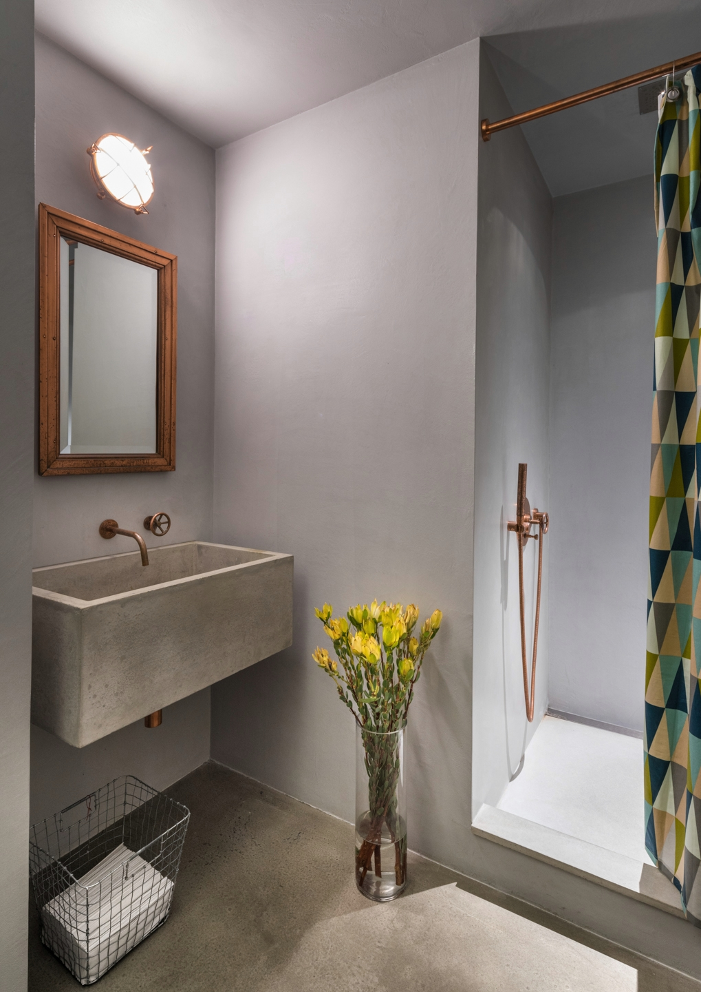 INC Architecture & Design Bathroom Sink and Shower