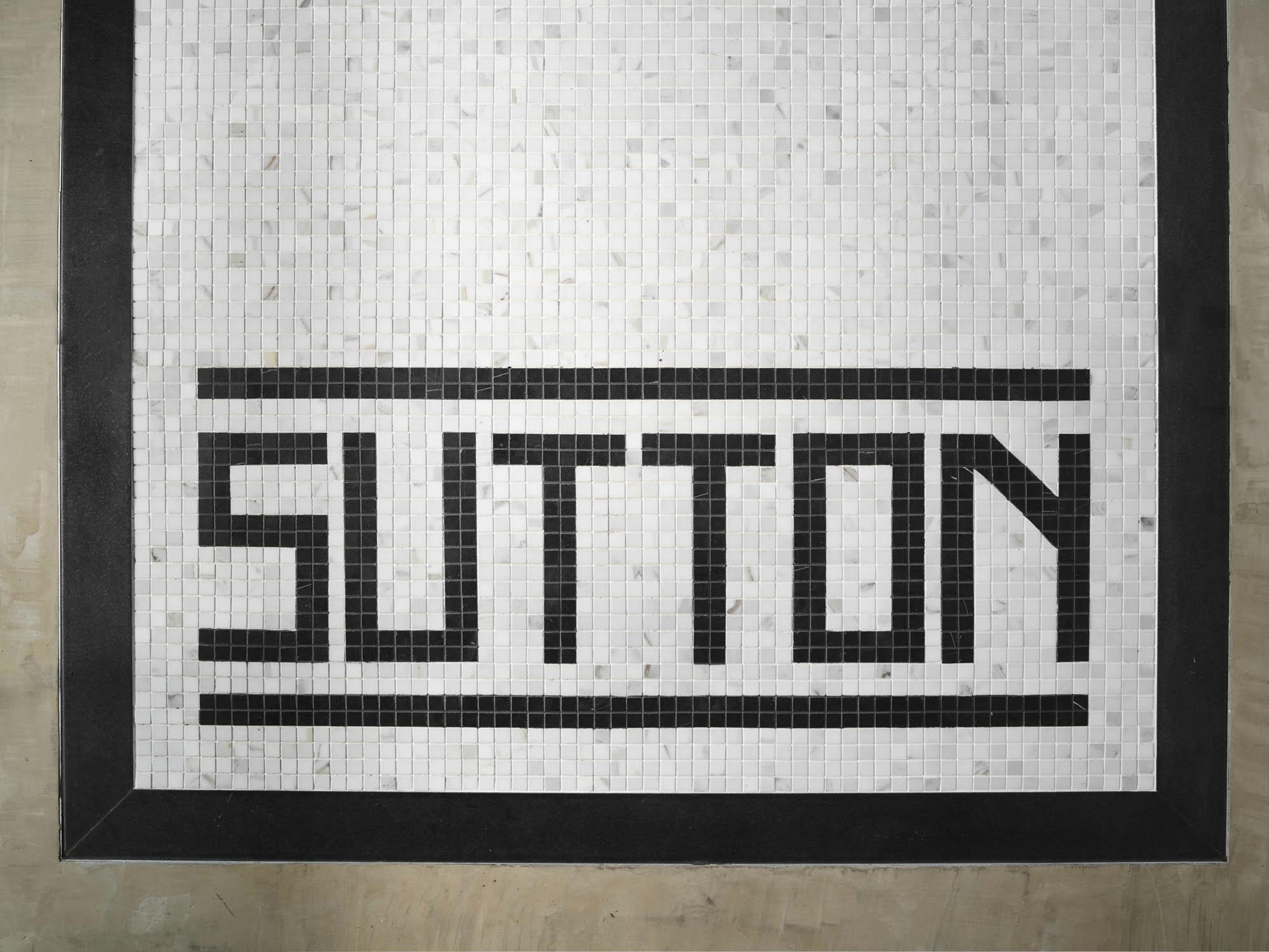 The Sutton Condominium Tile Floor Sign