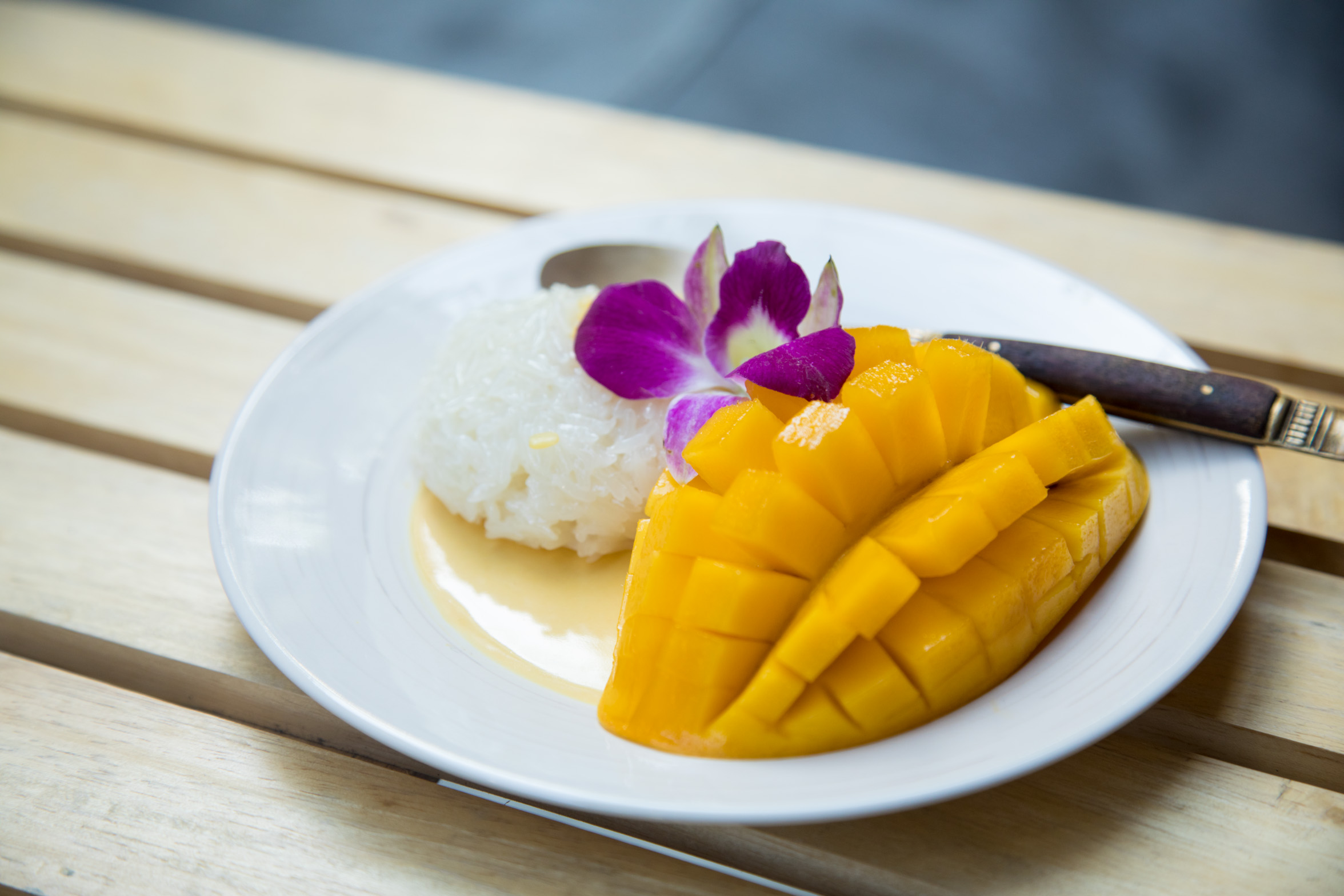 7. Mango Sticky Rice - As iconic as Pad Thai, this sweet dish is a quickie sold at almost every corner of Bangkok and takes less than two minutes to assemble. Sticky rice paired with half a diced mango garnished with cream and sesame seeds. Simple, uncomplicated with bags of flavours and textures, from sweet to starch and mush to crackling. A plate of Mango Sticky Rice doesn't cost more than 50 baht.