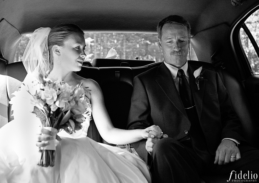 father and bride in limousine