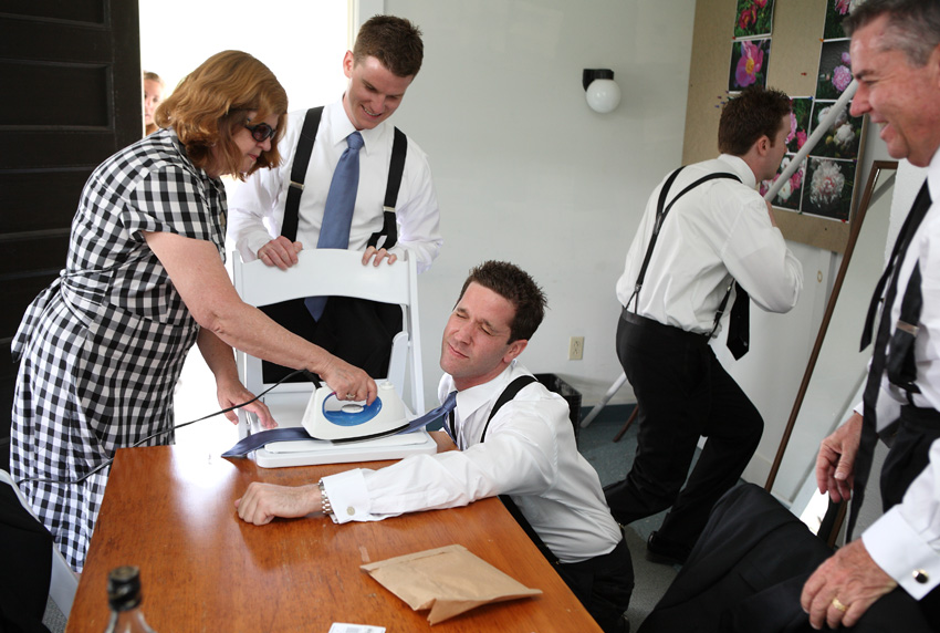 groomsman ironing tie