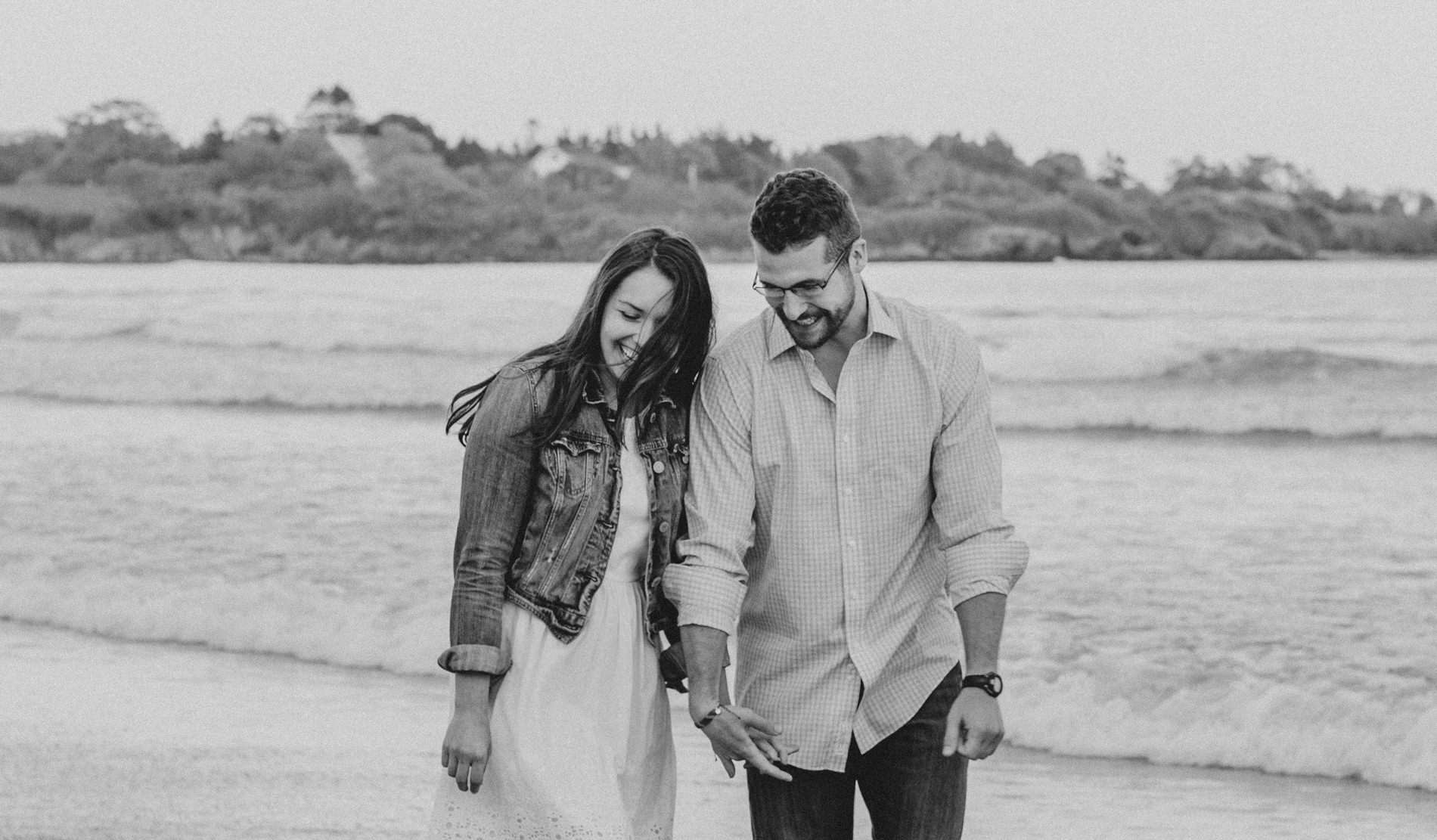 couple laughing during their maine engagement photos
