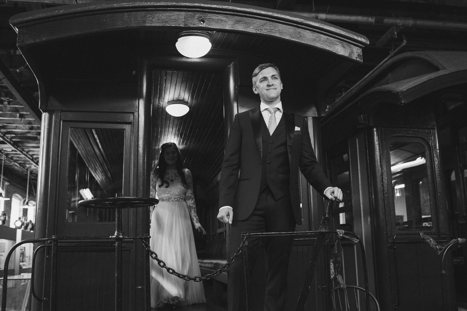 a bride and groom have a first look at the portland maine narrow gauge railway