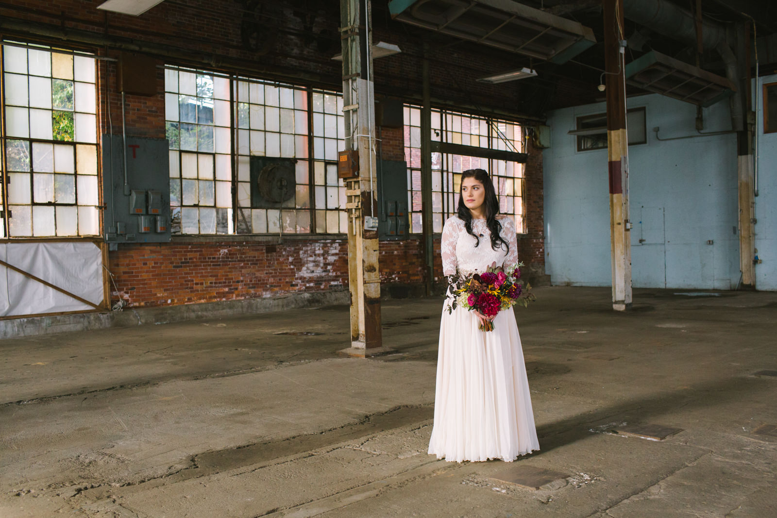 a bride at 58 fore in portland maine with her bouquet