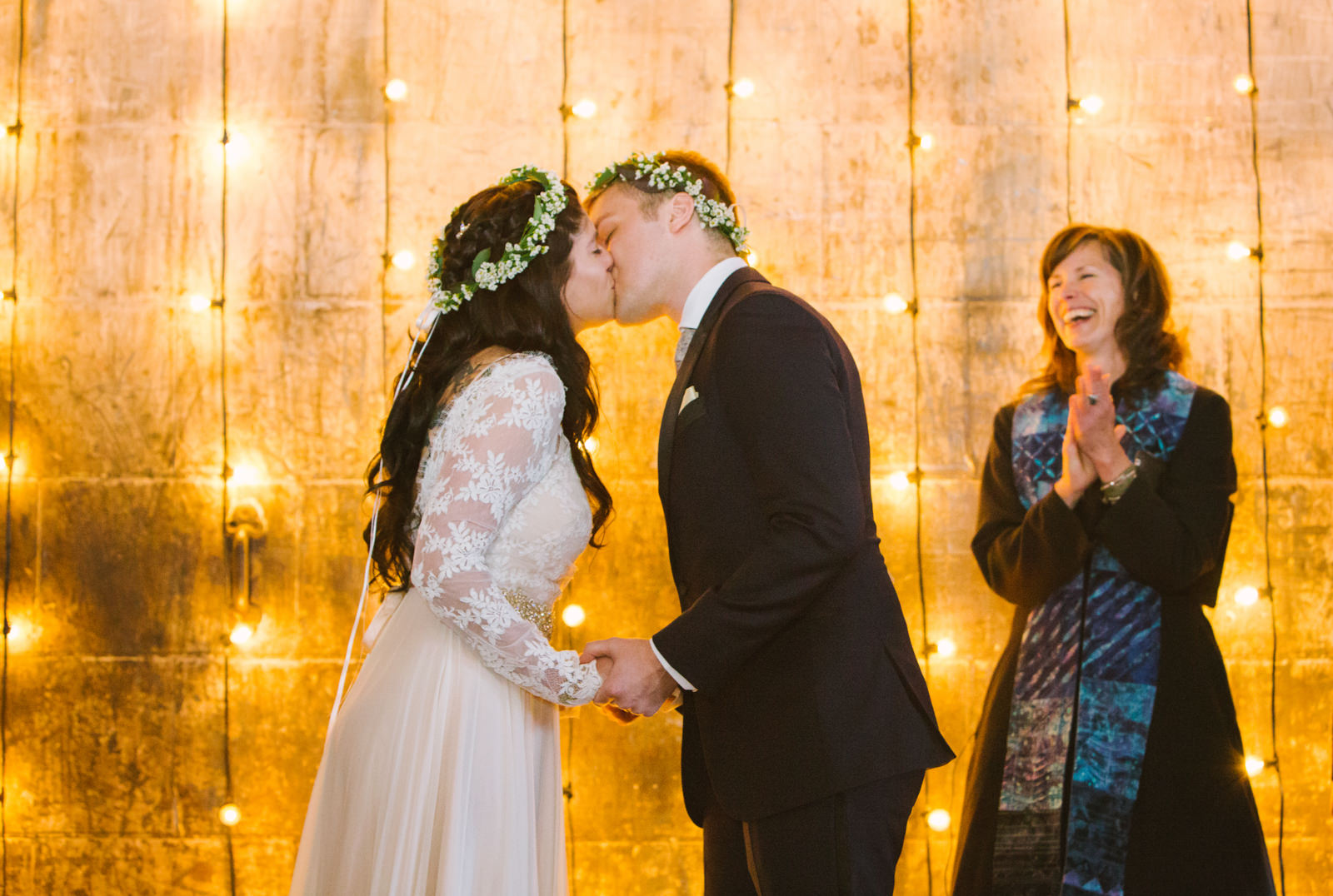 a bride and groom kiss at their wedding ceremony