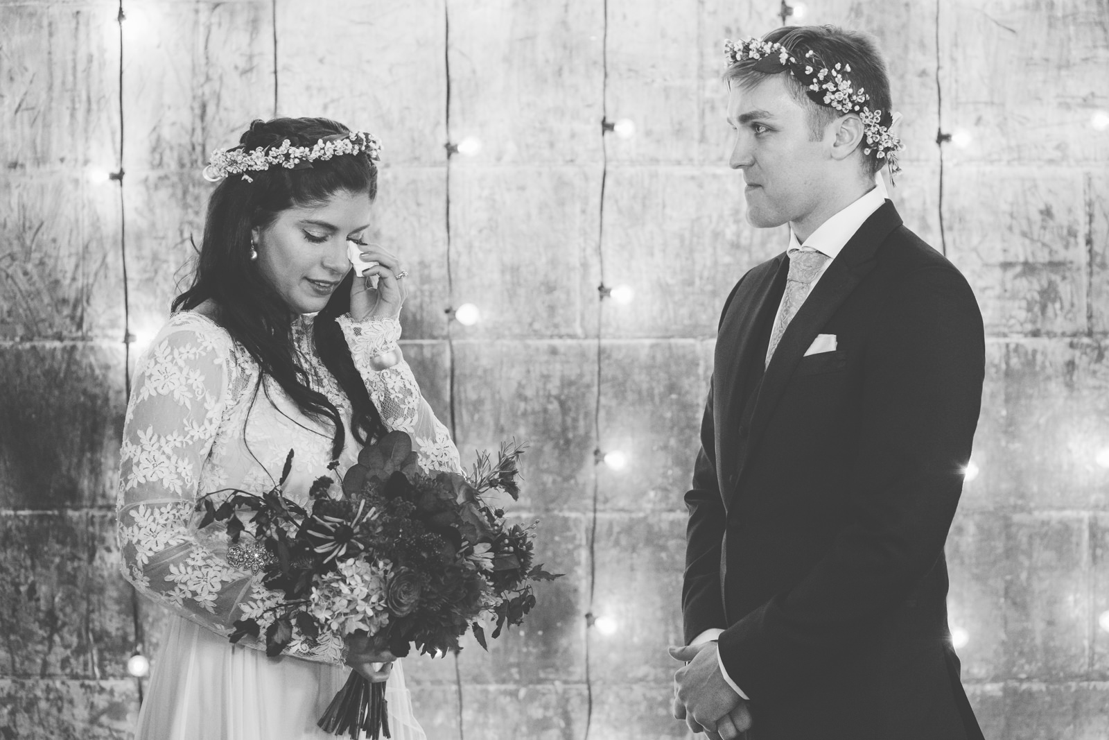 an emotional bride at her warehouse wedding in portland