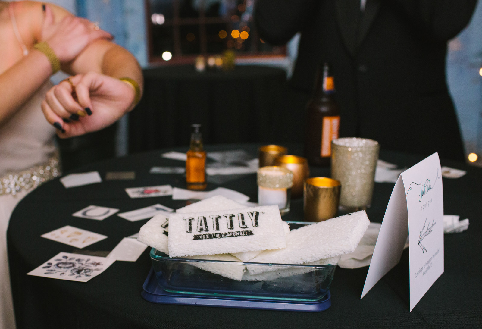 wedding guests put on temporary tattoos