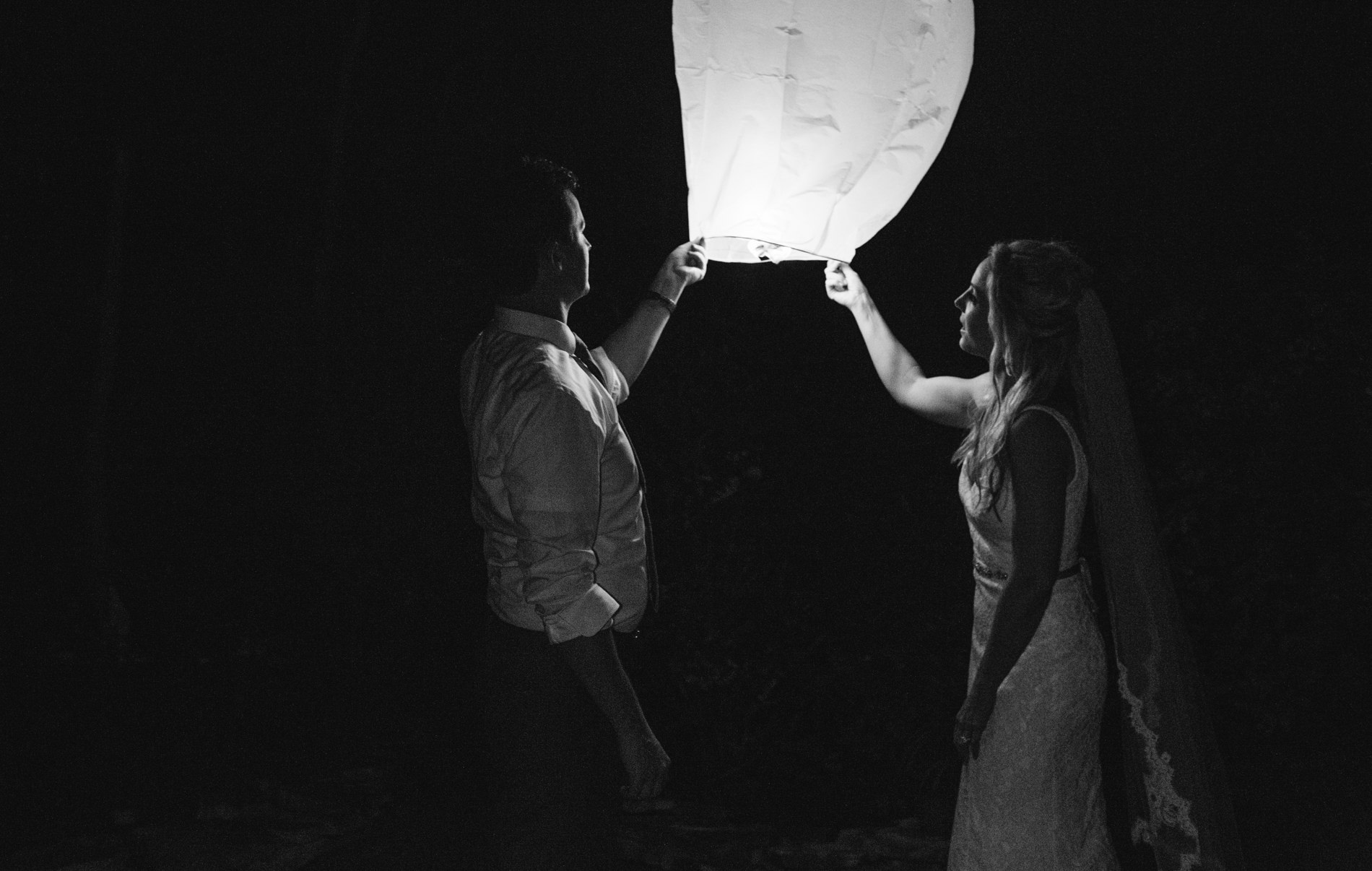 bride and groom launch a lantern