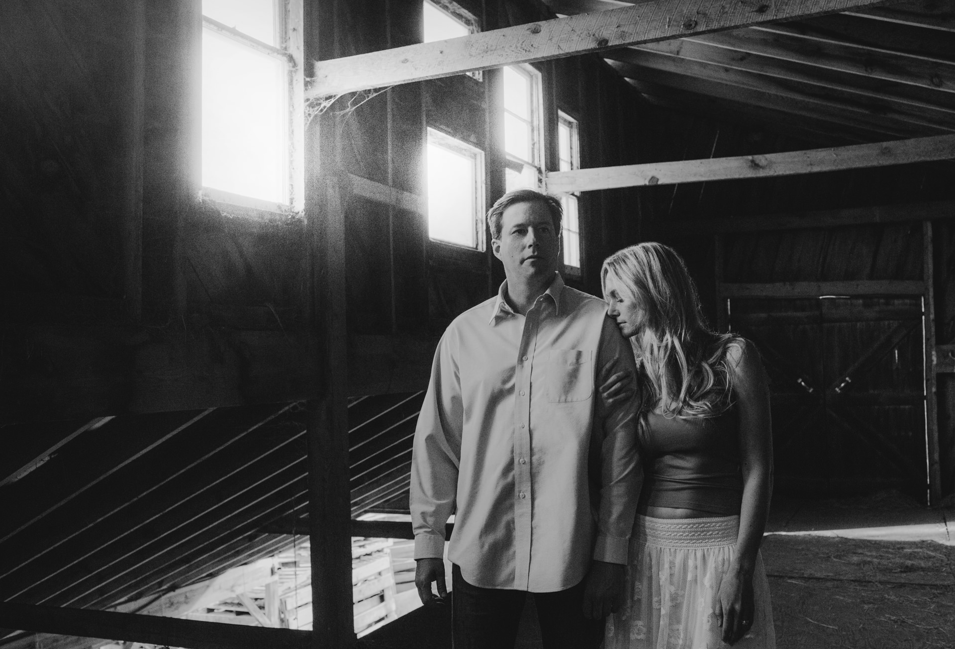 An engagement photo shoot in an old barn