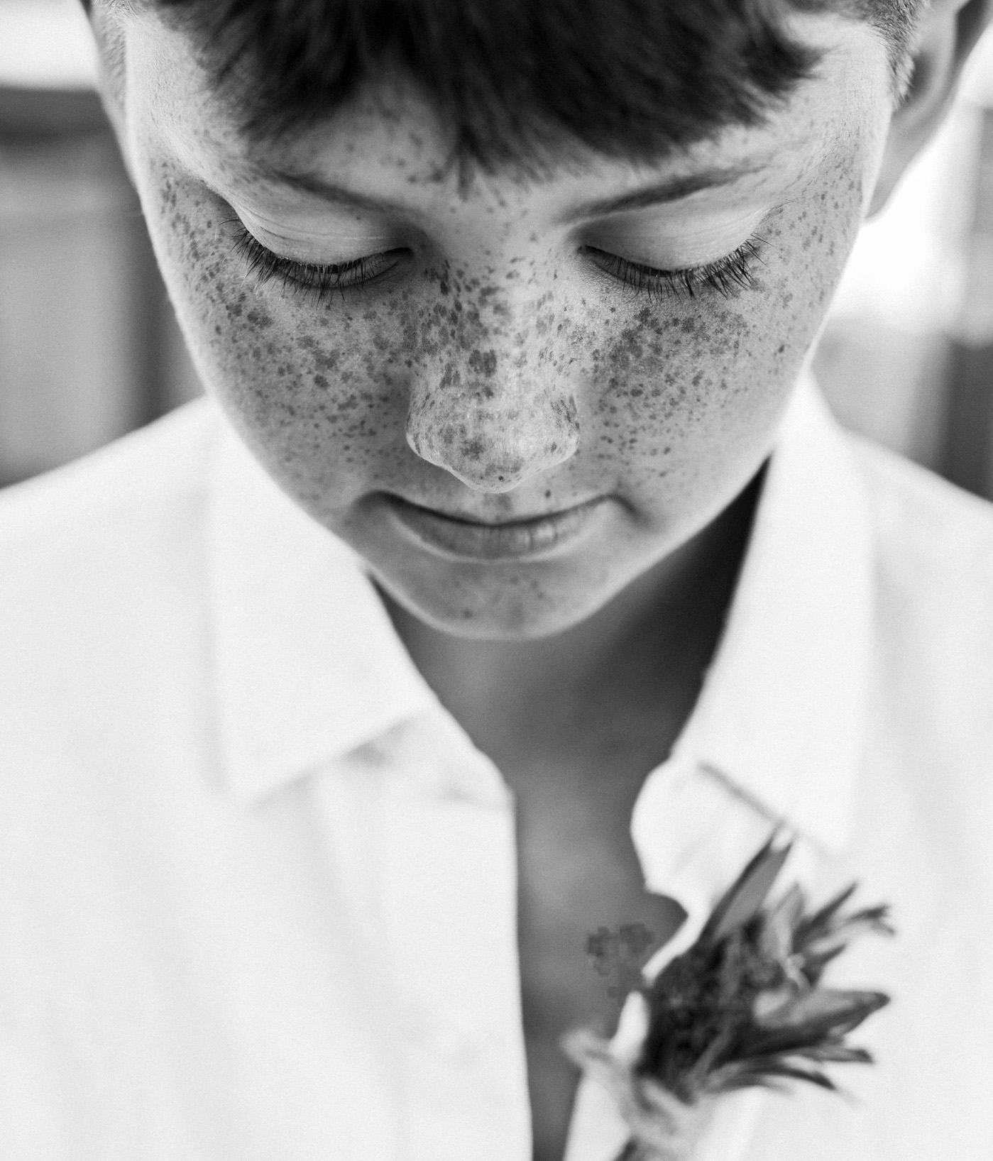 A freckled ring bearer at a Maine beach wedding