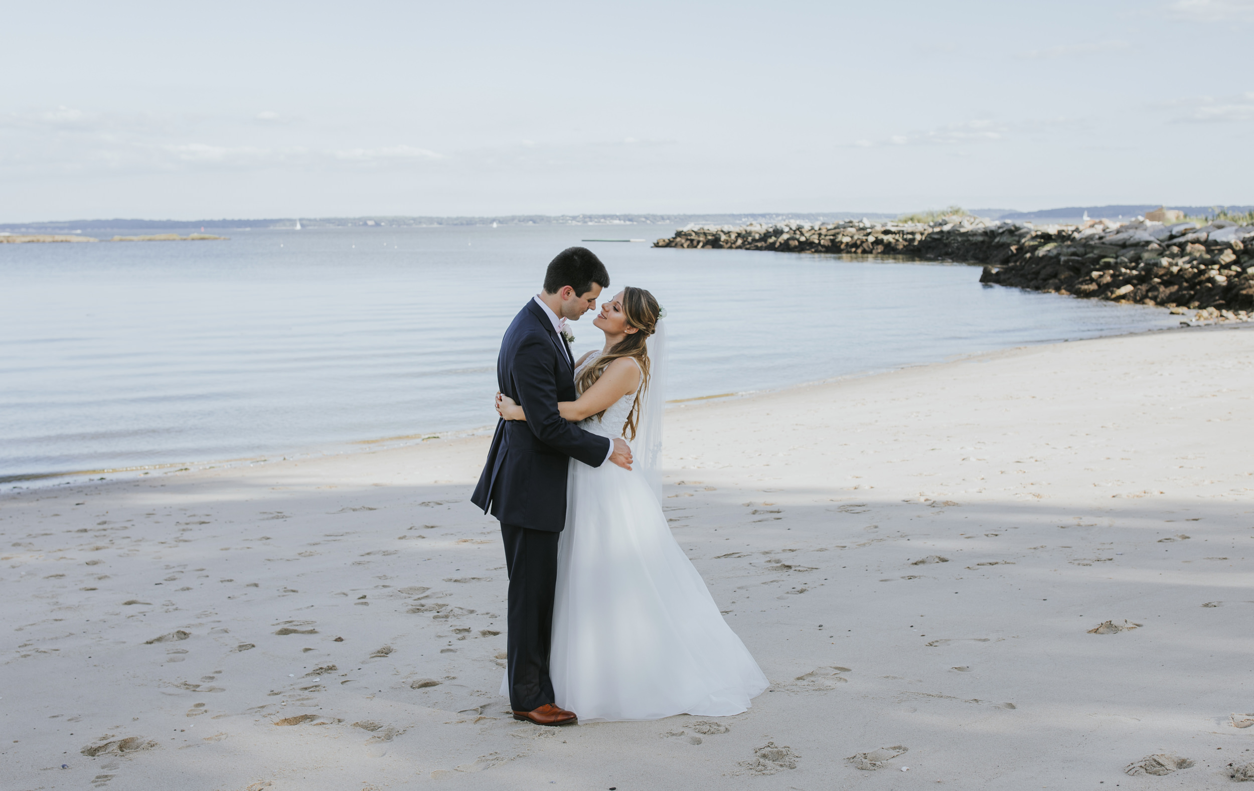 A couple at the beach on their wedding day