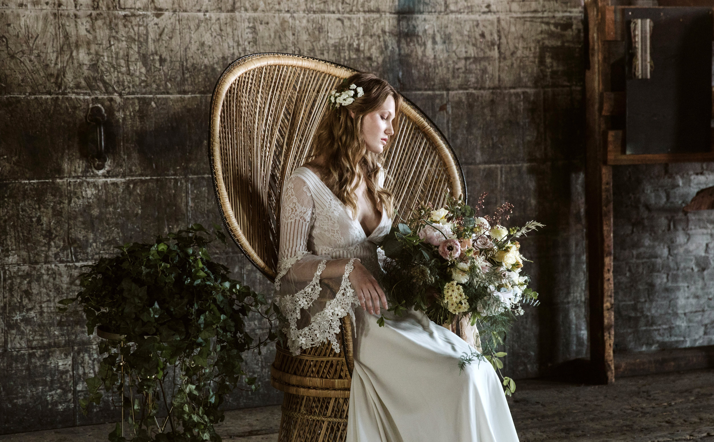 Bohemian bride in a peacock chair