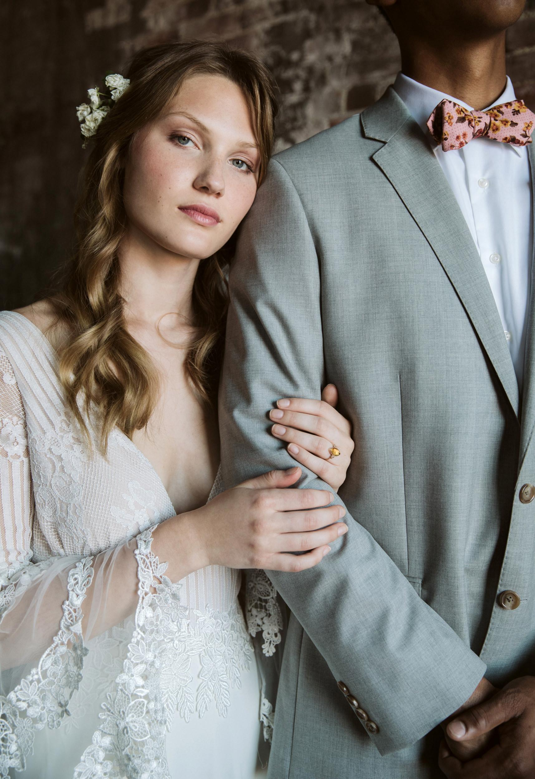Close up of bride leaning on groom's shoulder