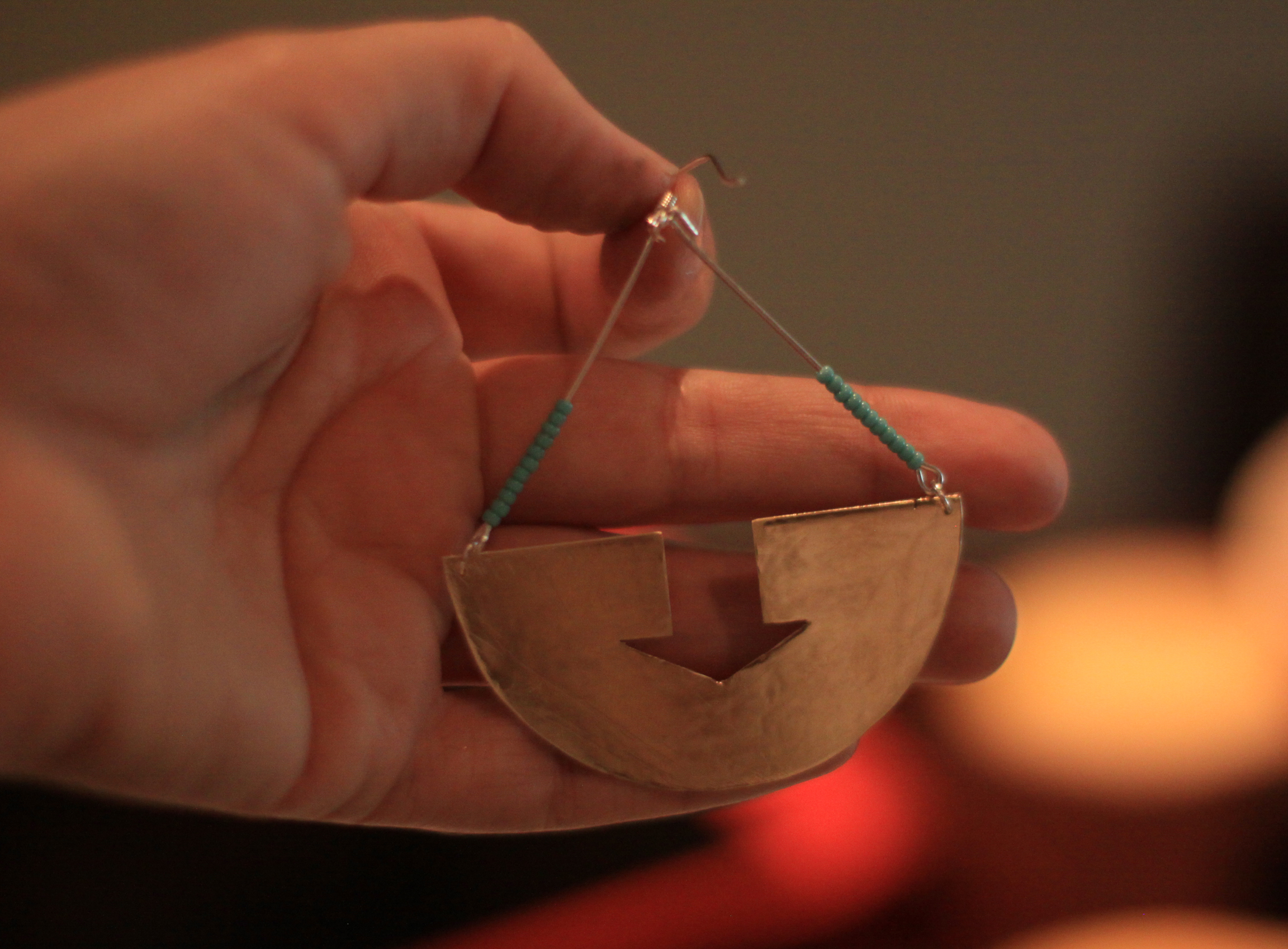7. One finished earring! Design - 11:11 earring designed and created by East of the Sun Denise and Shane Faddis