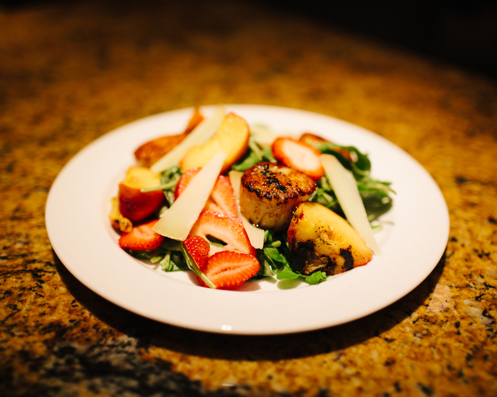 Seared scallop salad with grilled peaches, strawberries, shaved pecorino toscano, and  peach balsamic vinaigrette