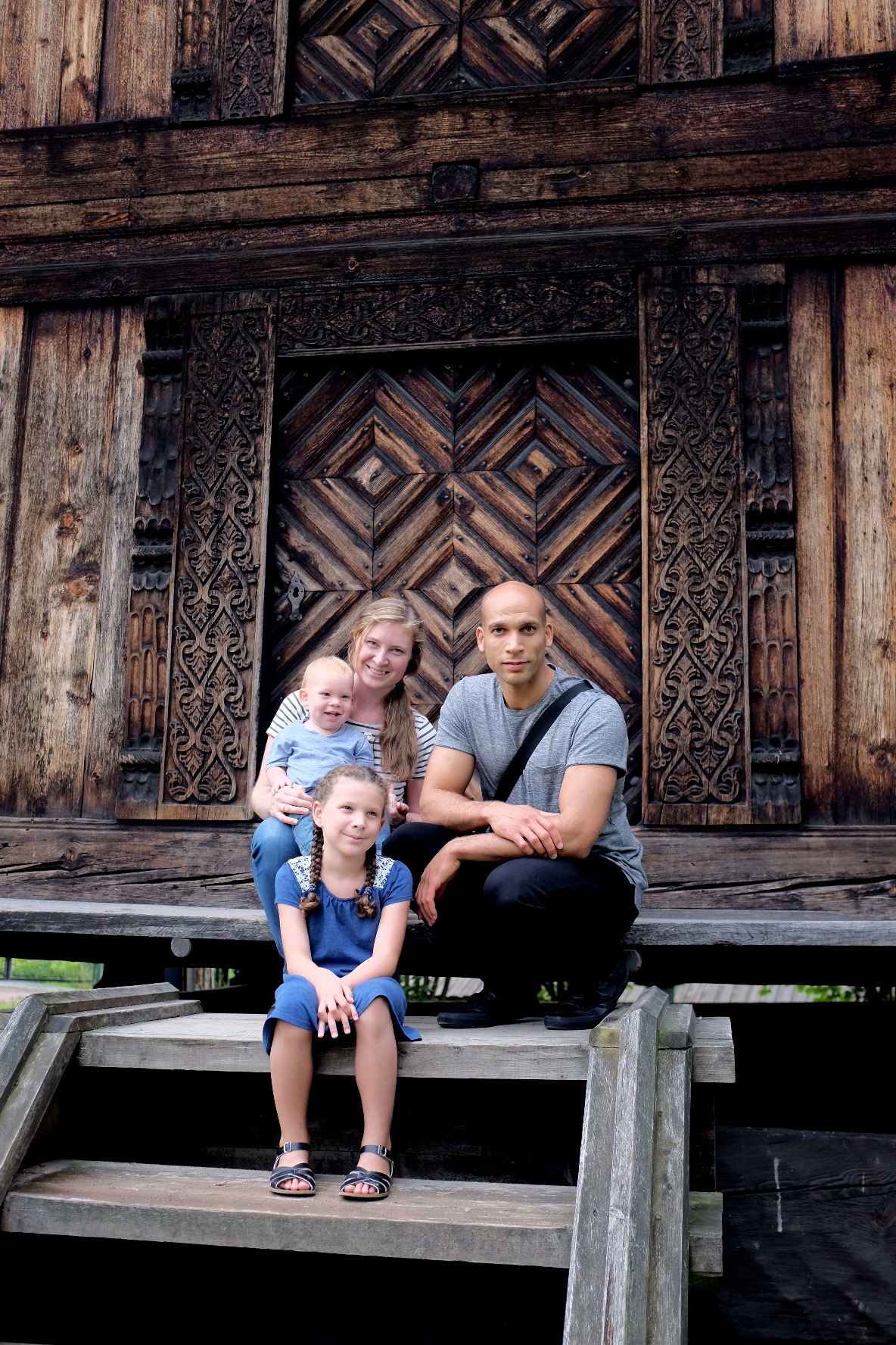 Daniel, Janel & Co posing by a traditional Norwegian house in Oslo.