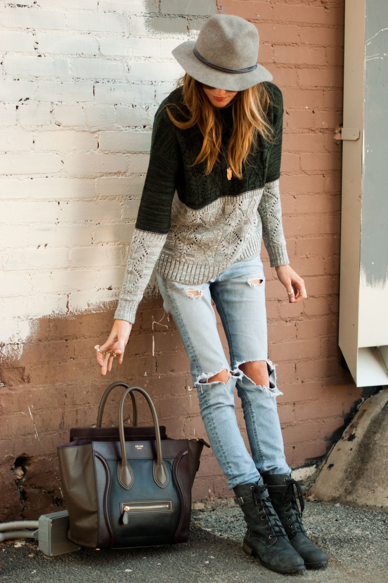 DistressJeans - I love distressed jeans, always have. I dress pretty casual and like it when girls do too. I'm not a big fan of heels unless it is with a very dressy, dress. No chunky, big boots!________________________Distressed jeans are my kind of classy.