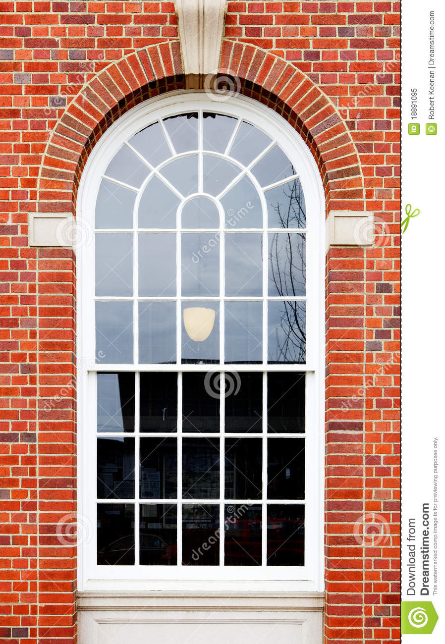 arched-window-brick-wall-18891095.jpg