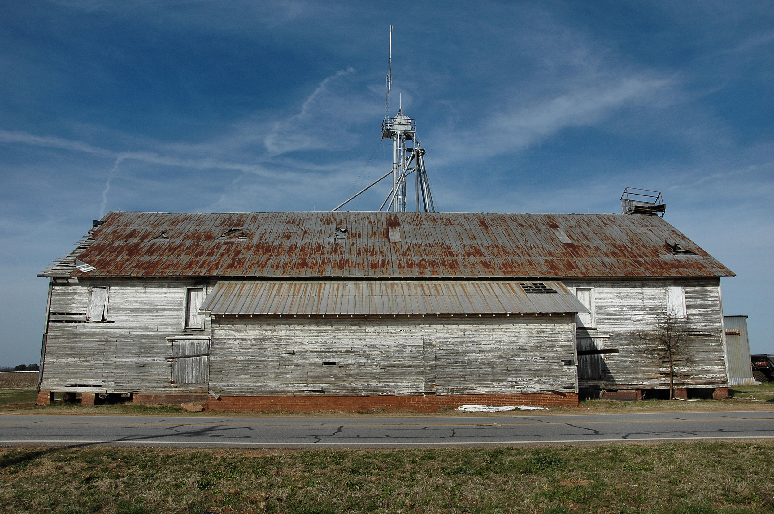 miami-valley-ga-peach-county-packing-shed-barn-large-rusted-tin-roof-southern-rural-southern-photo-copyright-brian-brown-vanishing-south-georgia.jpg
