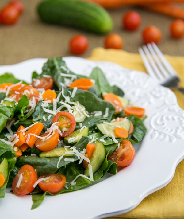 Spinach, cucumber, tomatoes. Add cheddar or parmesan cheese and mandarins, broccoli, chicken, slivered almonds, mushrooms and Reduced Fat Parm Ranch dressing.