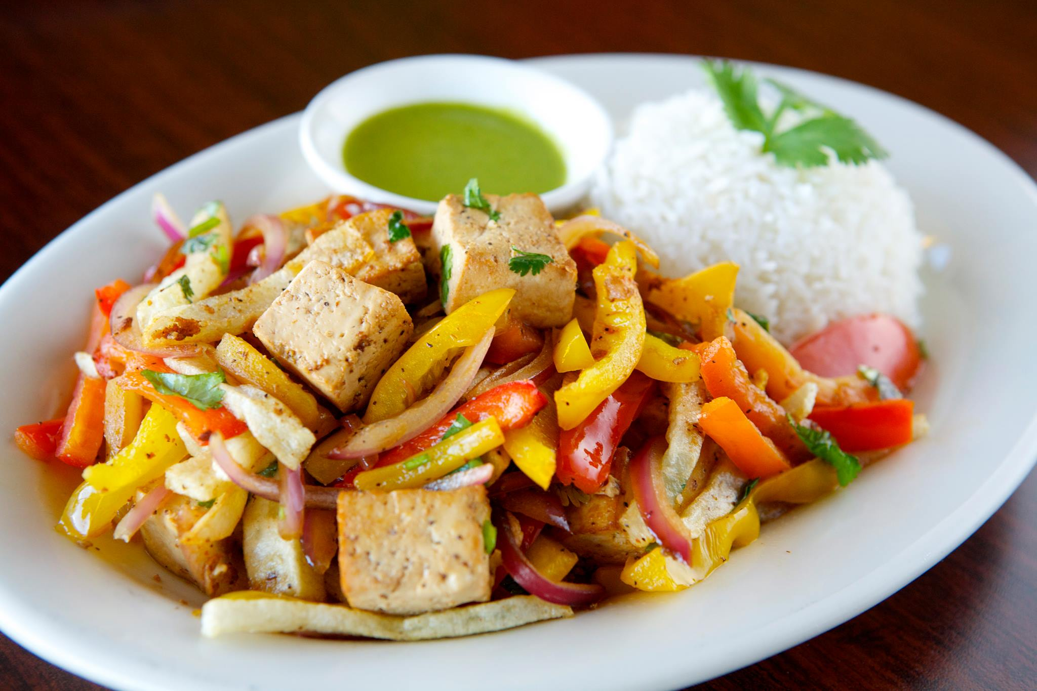Saltado    Peruvian entree with Chinese influences (chifa).   Lean beef  ,   chicken breast  , or   organic tofu   tossed with tomato, red and yellow peppers, red onions, and homemade French fries. Served with steamed rice (white basmati or brown) and house citrus salsa.
