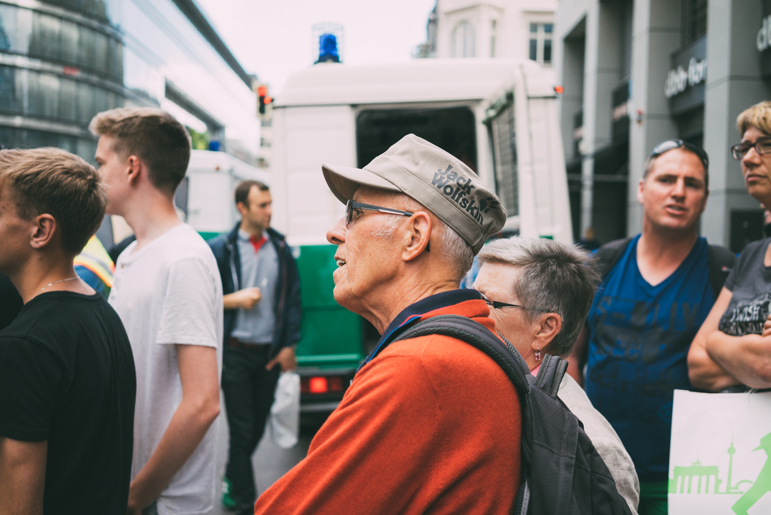 Older gent looks on as the rally forms