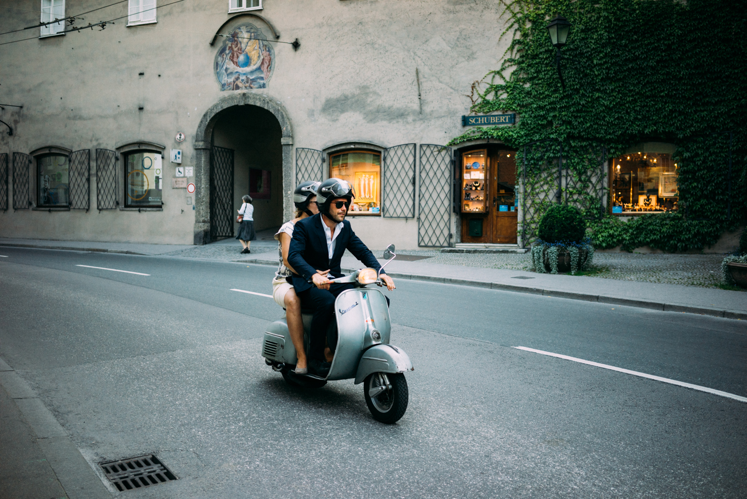 Looking slick on a moped.