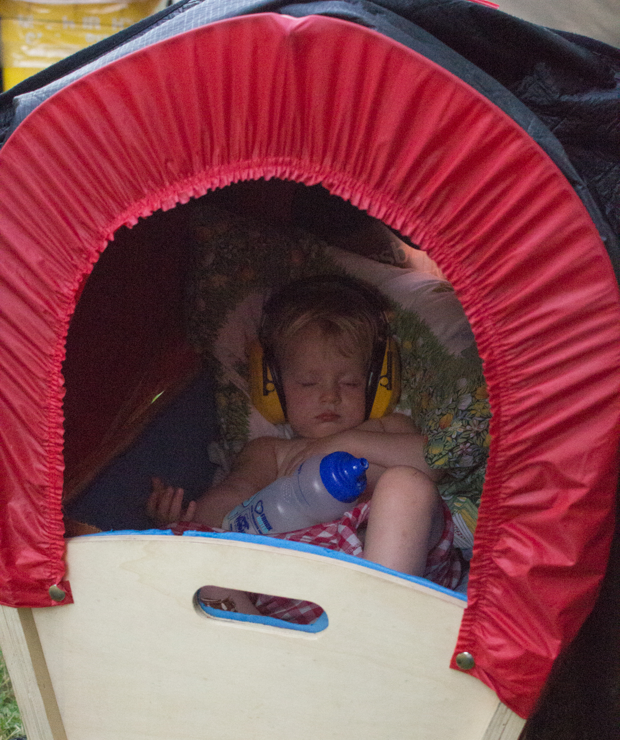 Frankie sleeping in her wagon at Womad