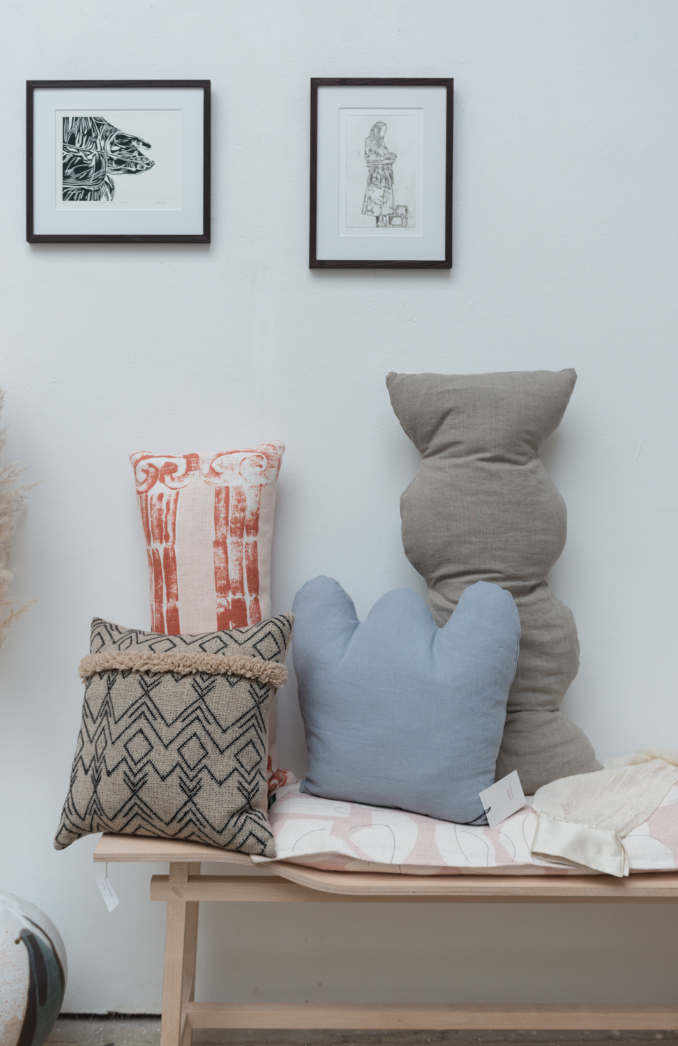 Shape cushions by aeand studio. Other cushions by Vicky Cowin and Stoff studio. Prints by Sophie Nicole Dodds. Peckham craft show 2019.