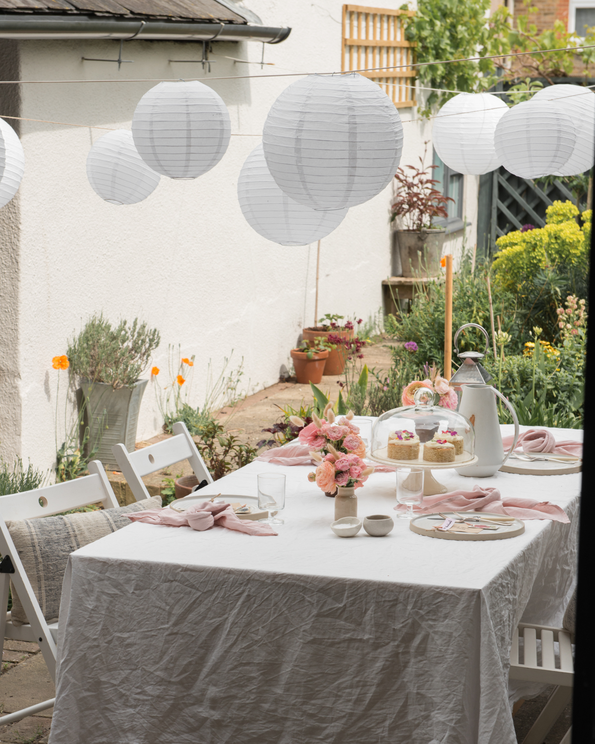 Garden afternoon tea, handmade plates, white paper lanterns, tips from a stylist, stylists tips, how to lay a table,