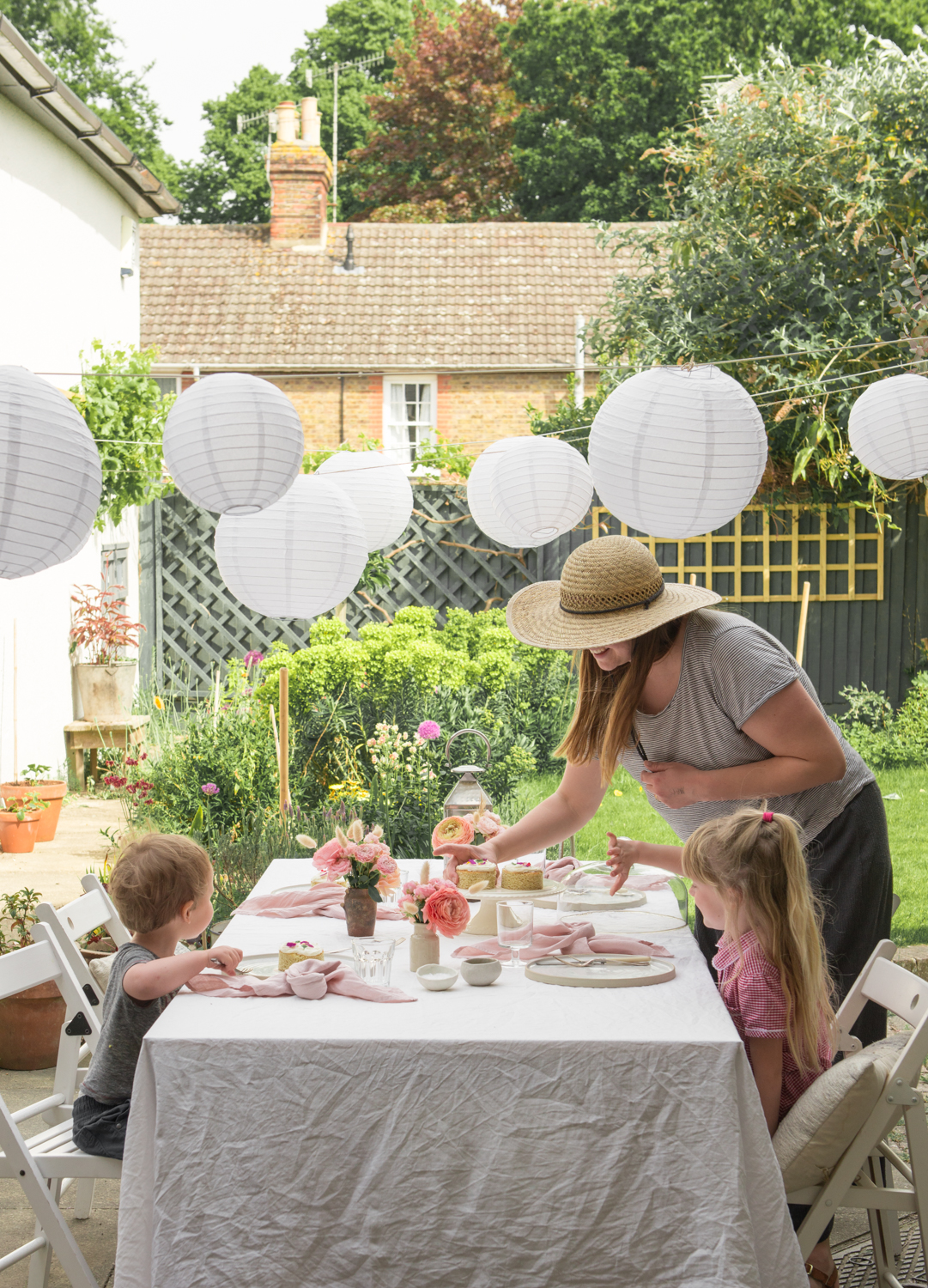 How to lay the table, outdoor afternoon tea, handmade plates, linen, DIY place settings, white paper lanterns, kids afternoon tea, stylists tips, how to style a table,