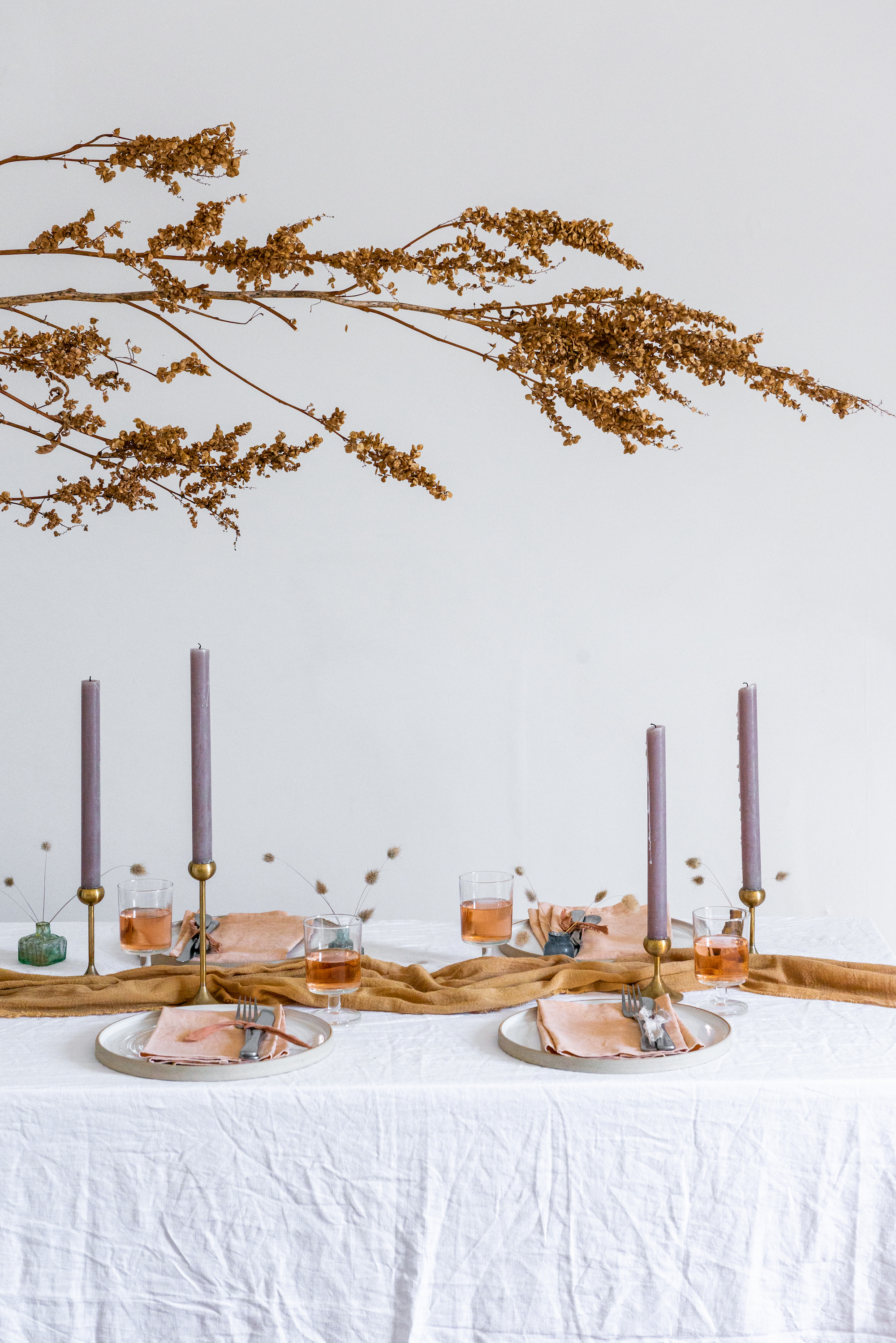 Autumn table, dried flowers, table styling, table setting ideas, how to lay a stylish table, how to lay a table, dinner party decorations, peach and lilac colours, tonal table, handmade plates, naturally dyed linen, rustic candles, dried flower arrangement, minimal table , simple table, DIY table styling, How to style a table, how to host a stylish gathering | HannahBullivant.com
