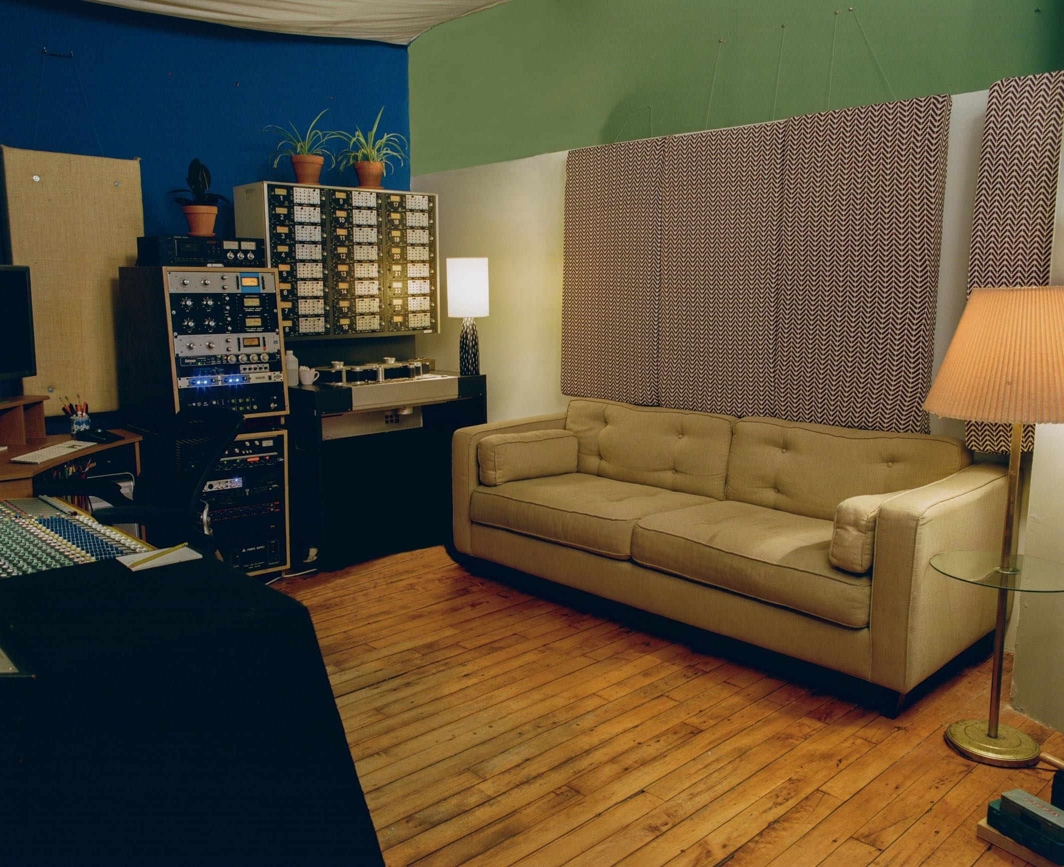 Control Room of Look to Listen Studios with rack gear and Studer tape machine and couch for artists and clients
