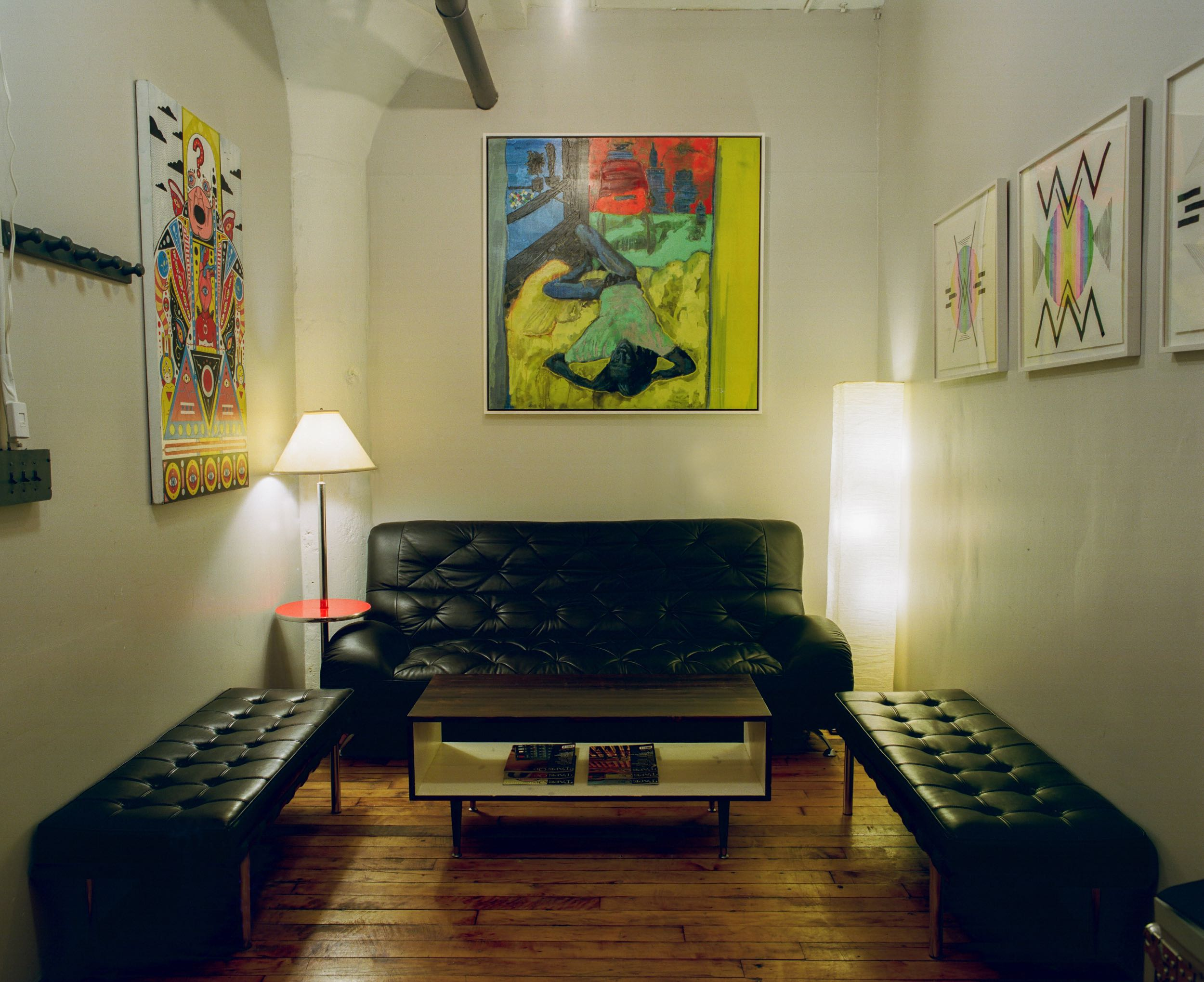Lounge and Reception Area of Look to Listen Studios leather couches and artwork by Drjuchin and Castator