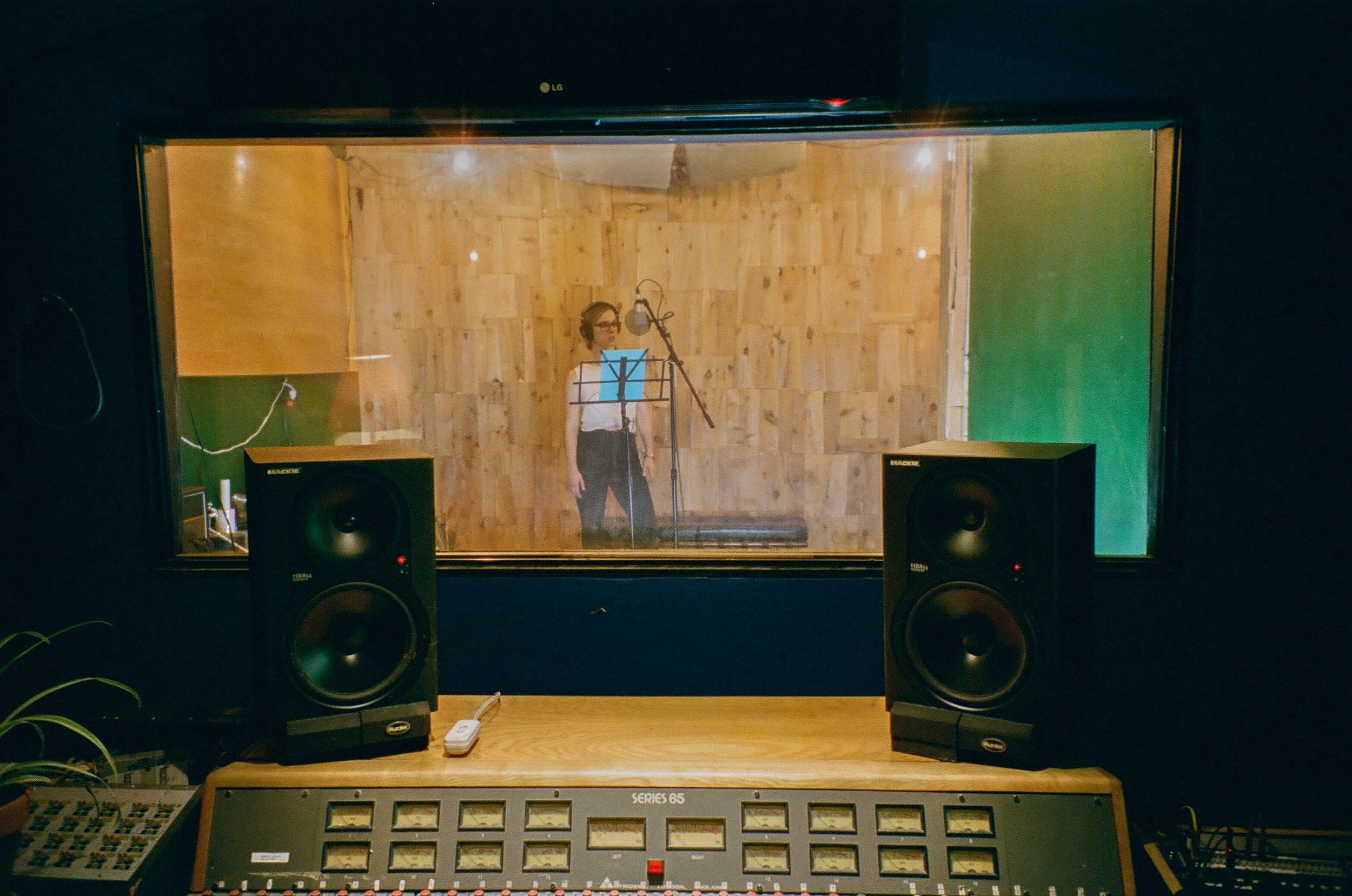 Voice-Over Session with Julia Jade Duffy from behind the glass in the Look to Listen Studios control room.jpg
