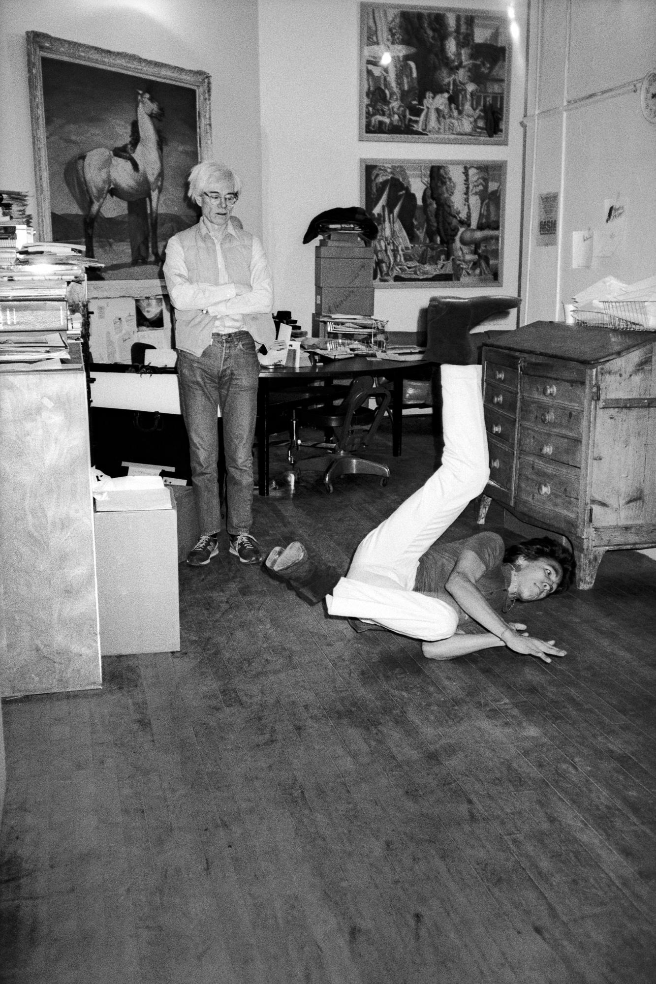Andy Warhol with artist/break-dancer Doze Green, 860 Broadway.  (1982)