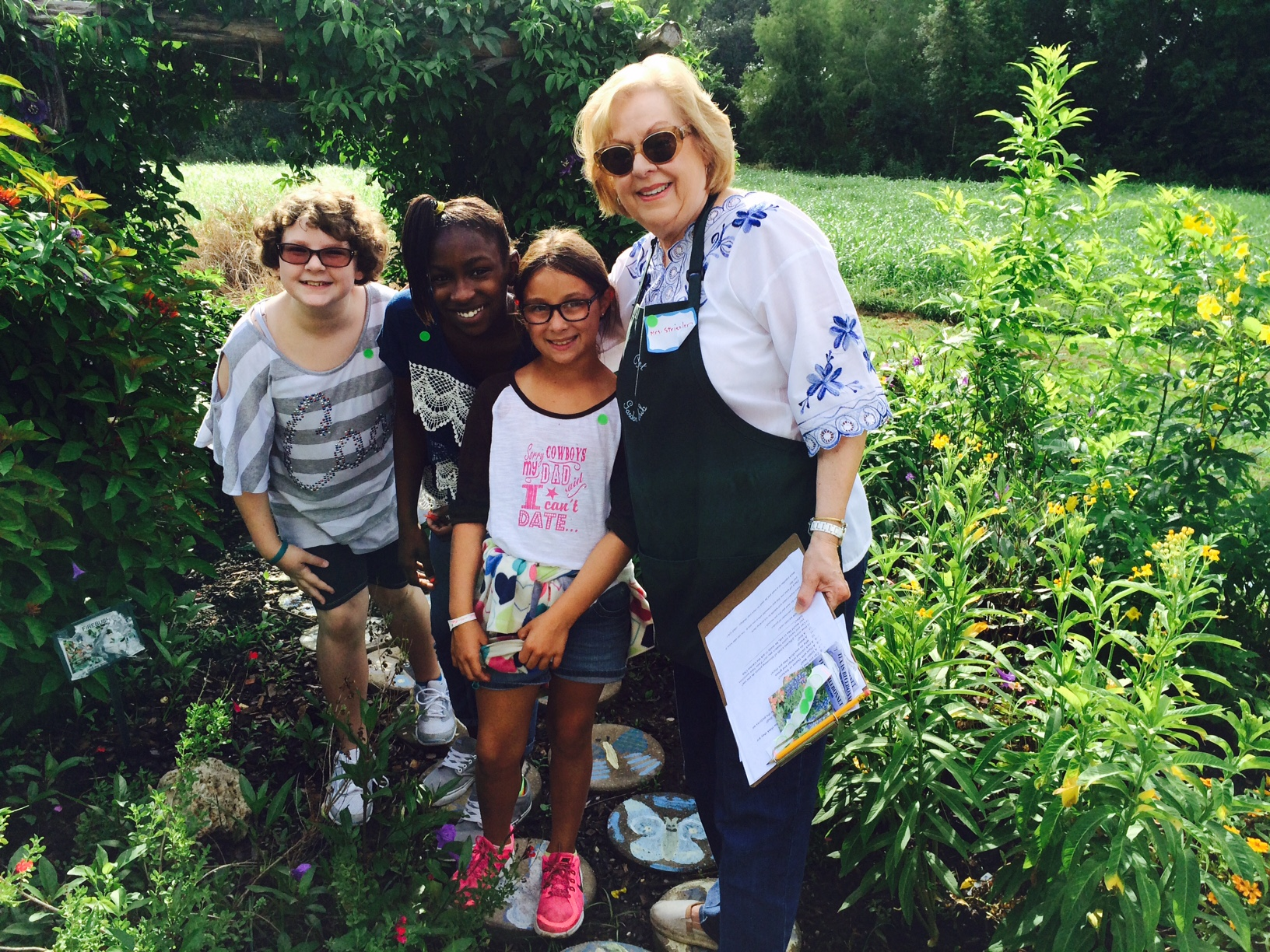 Betsy Striegler with Fourth Graders Butterfly Garden.jpeg