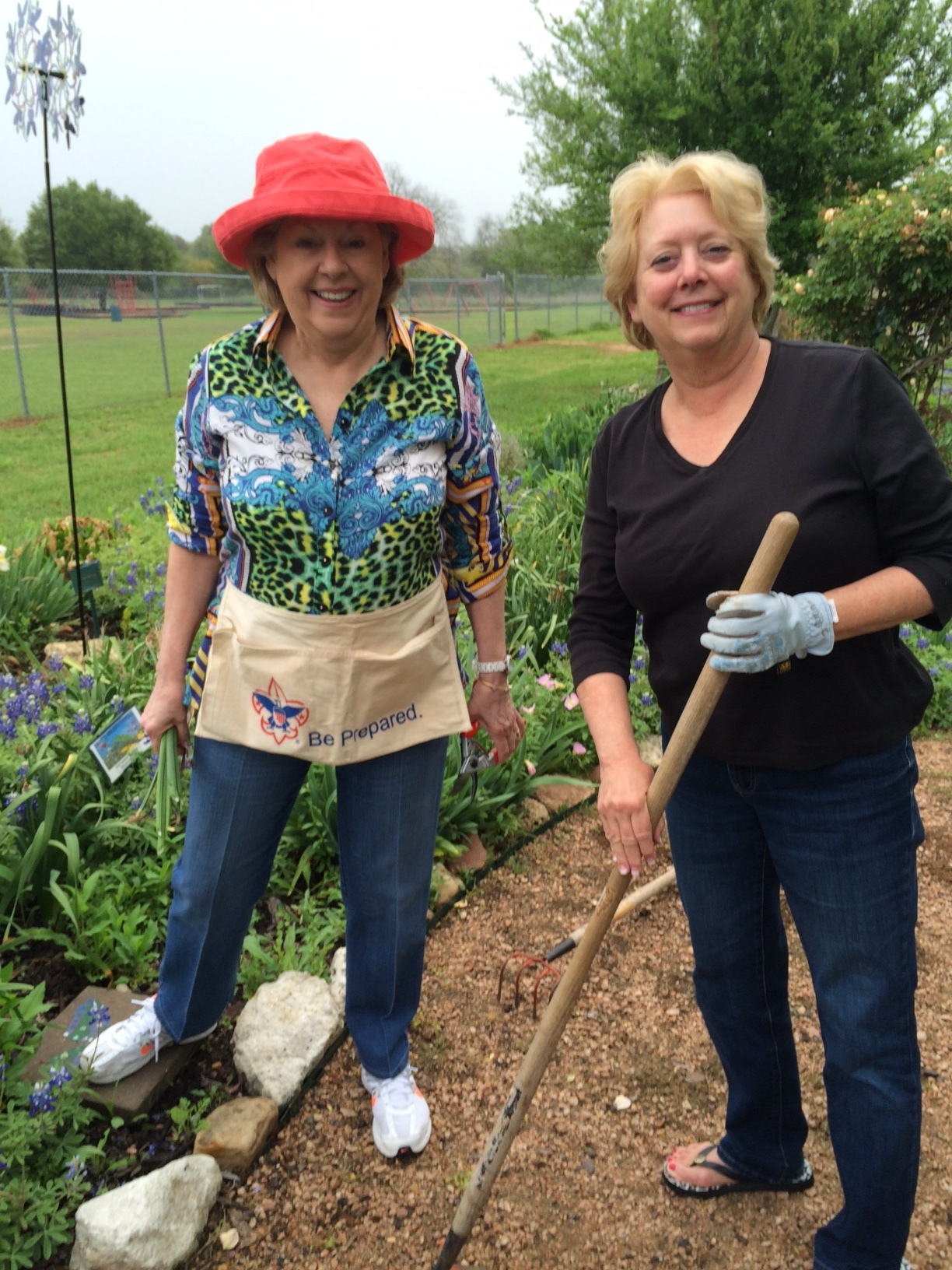 "Betsy Striegler and Linda Blum help the ""weekly Weeders"" with garden maintenance. A donation by a member will be used to purchase a tree to be planted along the path of the outdoor learning center in an Arbor Day program. (Reported by: Twila Tate)"