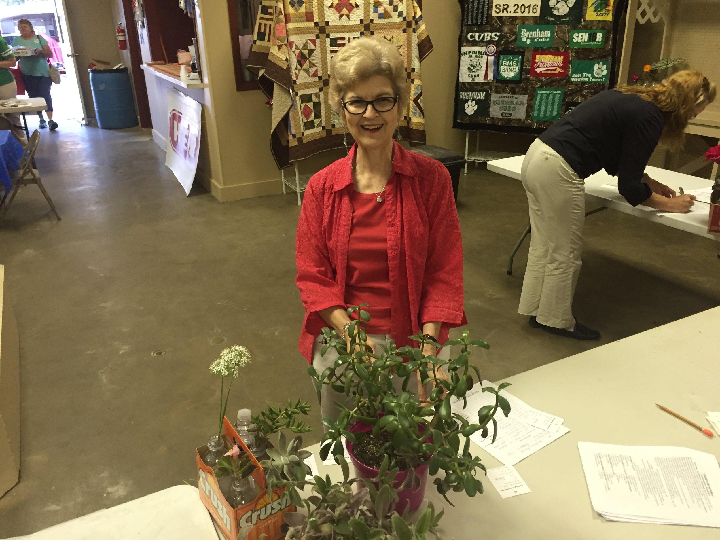 Donna Bennett checking in entries.