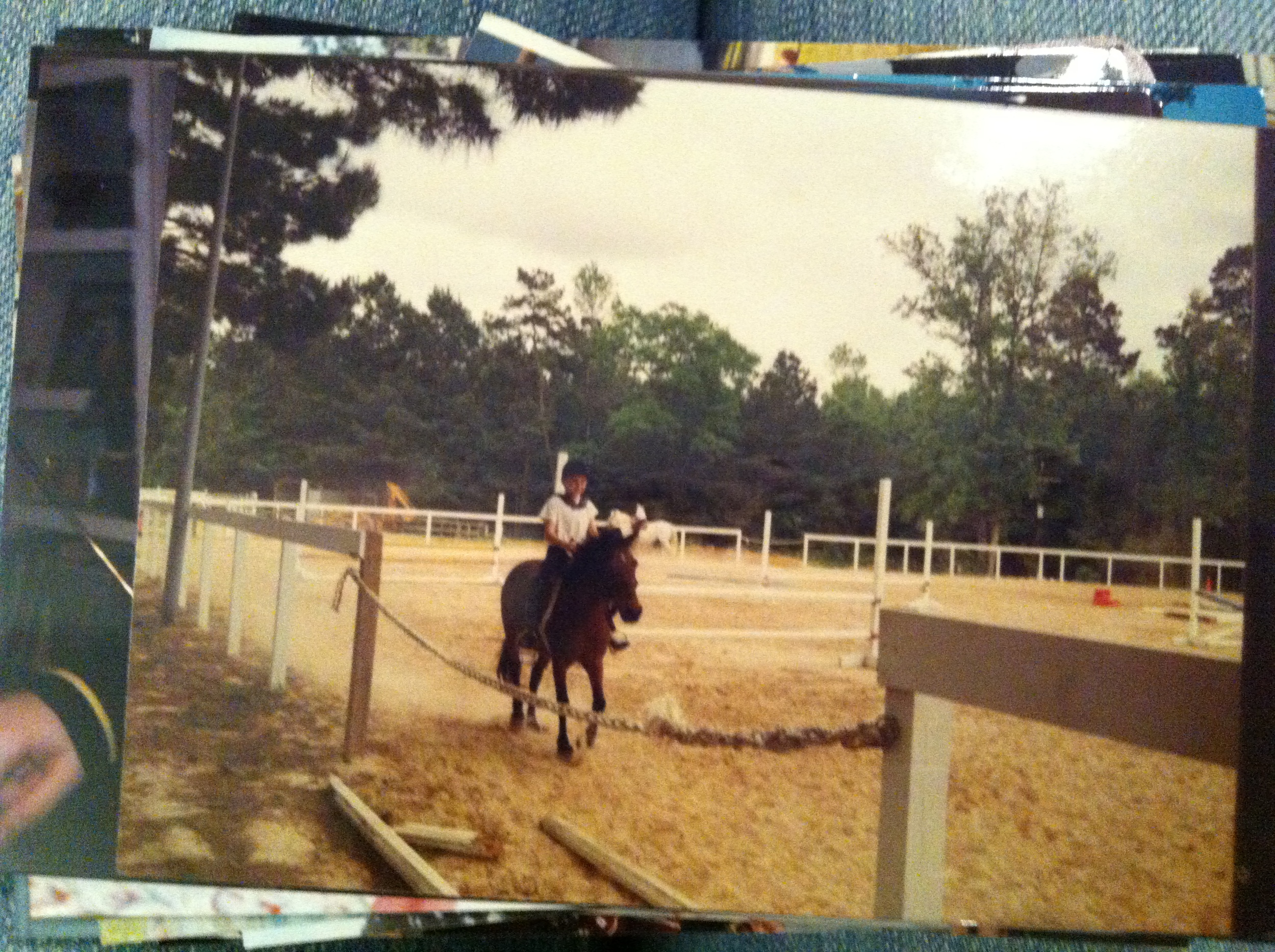 Little me taking riding lessons. Yep, it's a picture of a picture because I forgot my iPhone that day.