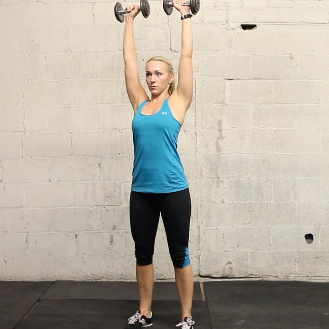 standing dumbbell overhead press