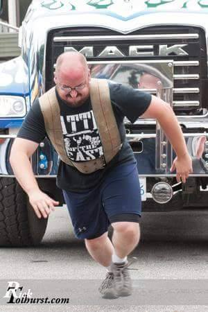 Joel pulls a truck in a strongman competition