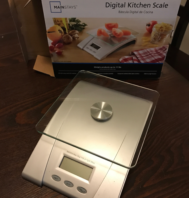 My food scale. Cheap, effective, and well used.