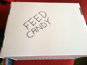 "The ""FEED CANDY"" slogan comes from the game."